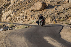 Leh,India - July 12,2014 : Biker riding on the road. Leh, a high-desert city in the Himalayas, is the capital of the Leh region in northern India's Jammu royalty free stock photo