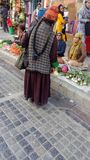 Street market and elderly tibetan woman stock photo