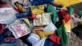 Tibetan colored flags with mantras and books. Leh, Ladakh, Jammu and Kashmir/ India - 10.08.2018: Tibetan colored flags with mantras and books royalty free stock photo