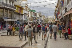 Tourist pedestrian shopping street with lots of people royalty free stock photos