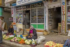 Vegetable local market on the street and a man buys products stock photos
