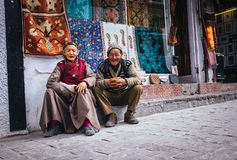 Leh , Ladakh region , India - August 20, 2016: Old people couple. Carpet sellers portrait on the street in Leh, India Royalty Free Stock Image