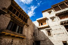 Leh Monastery looming over medieval city of Leh Royalty Free Stock Photos