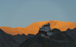 Leh stupa sunset moment. This stupa is in center of Leh. I taked it in sunset time. Back mountain get orange color and the front get dark color Stock Photo