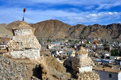 Leh town with stupas and mountains. Leh, Ladakh (little Tibet), India - Aerial view of Leh, Capital of the region, with the mountains in the background and stock photo