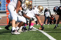 Lehigh Moutain Hawk Offensive Linemen. Get ready to snap the football Royalty Free Stock Photo