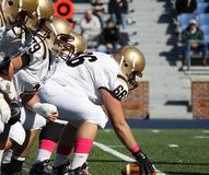 Lehigh Moutain Hawk Offensive Linemen. Get ready to snap the football Royalty Free Stock Photography