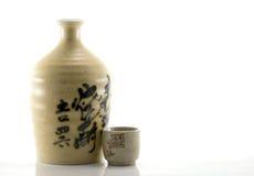 Lehm-Grund-Flasche und Cup Stockfoto