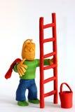 Lehmarbeiter mit Strichleiter Lizenzfreie Stockbilder