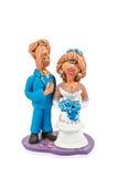 Lehmfigürchen der Braut und des Bräutigams Stockfotos