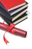 Lehrbücher und Rollen-Behälter Stockbild