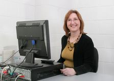 Lehrer am Computer Lizenzfreie Stockfotos