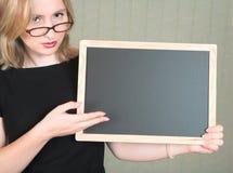 Lehrer mit Tafel Stockbild