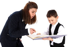Lehrer und Junge mit Buch Stockfotos