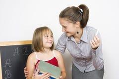 Lehrer und Kursteilnehmer Stockbild