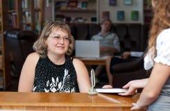 Lehrer und Kursteilnehmer Lizenzfreie Stockfotos