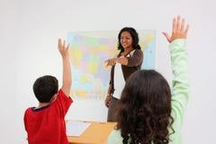 Lehrer und Kursteilnehmer Stockfotos