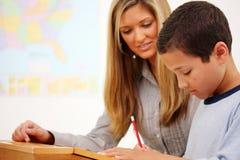Lehrer und Kursteilnehmer Stockbilder