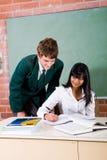 Lehrer und Kursteilnehmer Lizenzfreie Stockfotografie