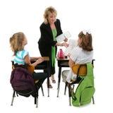 Lehrer und Kursteilnehmer mit Ausschnitts-Pfad Lizenzfreie Stockfotos