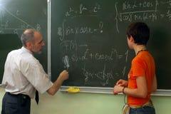 Lehrer und Schulmädchen lizenzfreies stockfoto