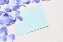Lei and note in sand Royalty Free Stock Images