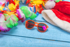 Lei, sunglasses and slippers Stock Photo