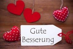 Leia corações, etiqueta, Gute Besserung que os meios obtêm bem logo Imagens de Stock