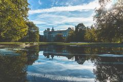 Leibniz university castle in Hannover Germany behind lake in autumn day stock photography