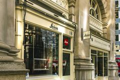 Leica Store City at the Royal Exchange, a premium shopping destination, on a sunny day. London, UK - March 20 2018: Leica store at the Royal Exchange, a premium stock photography