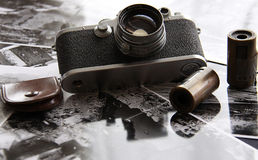 Leica, vintage camera. A respectable old camera with films and old pictures royalty free stock image