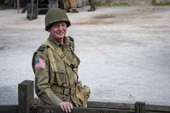 Man dressed in wartime US army soldiers uniform reenacting milit stock photo