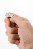 Leicht schlagen der Münze Stockfotos