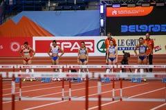 Leichtathletik - Hürden der Frauen-60m - ringsum 1 Lizenzfreie Stockfotos