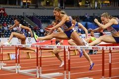 Leichtathletik - Hürden der Frauen-60m - ringsum 1 Lizenzfreies Stockbild