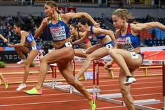 Leichtathletik - Hürden der Frauen-60m - ringsum 1 Stockbild