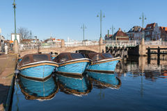 Motor boats docked in a canal of Leiden in the Netherlands Stock Photography