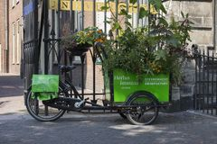 Leiden, Netherlands - July 17, 2018: Bicycle trailer with plants. At the entance of the Hortus Botanicus at the Rapenburg in the center of Leiden stock photography