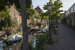 Leiden, Netherlands - September 17, 2018: Kijfgracht, houses alo. Ng a small canal in the centre of the city in late afternoon stock image