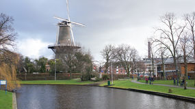 Leiden river near a windmill. A photo taken in Leiden, Netherlands, near the river and a typical windmill Royalty Free Stock Photo