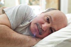 Leiden Sie unter Schlaflosigkeit lizenzfreie stockfotografie