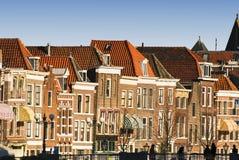 Leiden skyline. Old Dutch houses alongside a canal in the sun Stock Photography