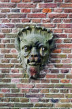 Leiden. Stone face on a brick wall. Holland Royalty Free Stock Images