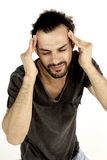 Leidende schlimme Kopfschmerzen des traurigen Mannes Stockbild