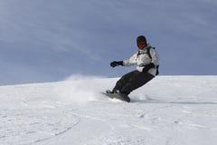 Leidenschaftliches Snowboarding-Mann-Treiben Stockfoto