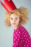 Leidenschaftsfrau in der roten Krone Lizenzfreie Stockfotografie
