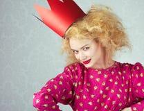 Leidenschaftsfrau in der roten Krone Lizenzfreies Stockfoto