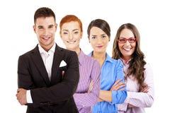 Leider en team, Jonge aantrekkelijke bedrijfsmensen Stock Foto