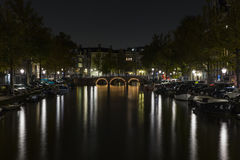 Leidsegracht bridge over Keizersgracht canal at night. Amsterdam, Netherlands Royalty Free Stock Photo