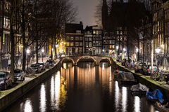 Leidsegracht Canal in Amsterdam at Night. A view along the  Leidsegracht canal in Amsterdam at night. Buildings, boats and buildings can be seen Stock Photo